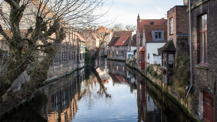 Popular touristic destination medieval historic city Brugge in West Flanders in the Flemish Region of Belgium. Brugge streets and historic center, canals and buildings
