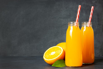 Foto op Canvas Sap Fresh orange juice in the glass bottle