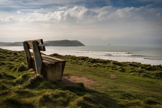Bench with a view over the ocean, Polzeath and Daymer bay, Cornwall, UK