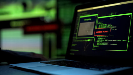 Message Access denied written on laptop screen, server blocking hacking attempt