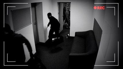 Masked thieves running off with bags of money, shooting in surveillance camera - fototapety na wymiar