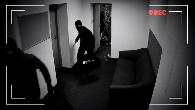 Masked thieves running off with bags of money, shooting in surveillance camera