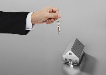 Real estate business, residential rental and investment. Businessman handover house key