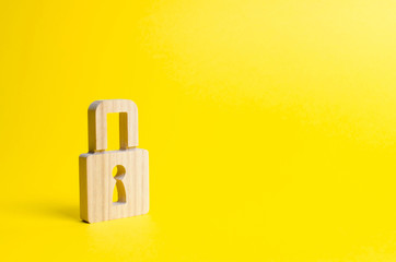 A padlock on a yellow background. information safty. concept of the preservation of secrets, information and values. Hacking attack, hacking. Protection of data and personal information. Wall mural