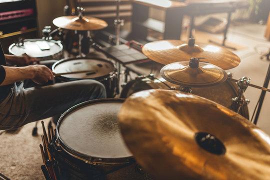 Drummer recording drum sounds, Sound recording studio.