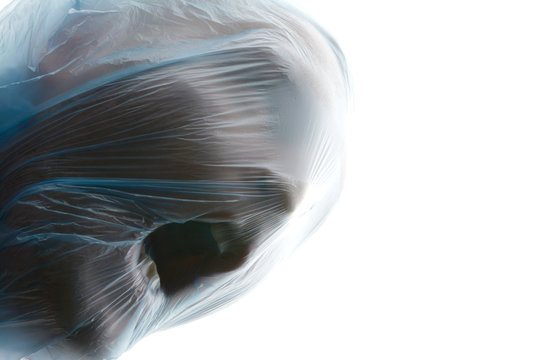 Choke. A man with blue transparent plastic bag over his head is suffocating. Suffocation. Copy space for text.