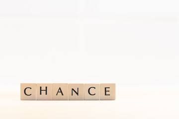 Wooden letters form the word Chance. Symbolic image for personality development and career development or change-yourself concept.