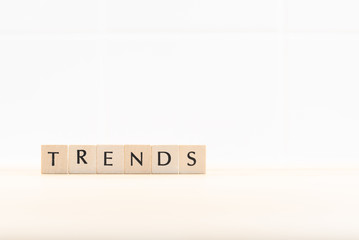 The word TREND from wooden letters. This year's trend concept.