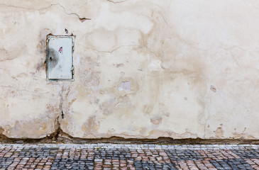 Electricity box on a dilapidated wall in the old town of Prague, Czech Republic