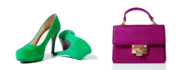 Closeup of fashionable high heels shoes and woman bag isolated on white background. Green color shoe and pink handbag on floor. Shopping and fashion concept. Copy space. Selective focus