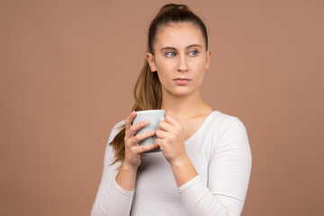 girl with a cup of tea and coffee