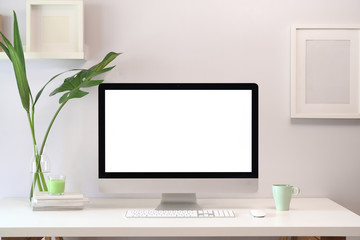 Wall Mural - Mock up loft creative workspace with blank white screen computer