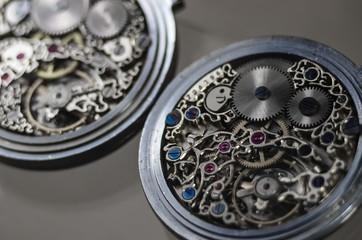 mechanism with gears. clockwork skeleton. Elegant vintage handmade pocket watches with exclusive carvings and engravings. jewelry.