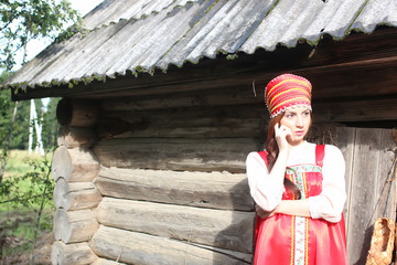 girl in traditional dress wooden wall