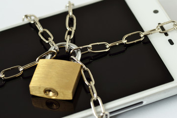Close-up of smartphone locked with chain and padlock - Concept of mobile security and data privacy