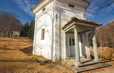 Panoramic view in the afternoon light on a winter day, of the seventeenth-century chapels of the monumental complex dedicated to the Virgin Mary, of the Sanctuary of Oropa in Piedmont, Italy.