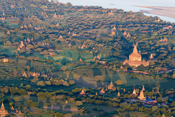 Flying over ancient temples in foggy morning, sunrise in Bagan, Myanmar (Burma)