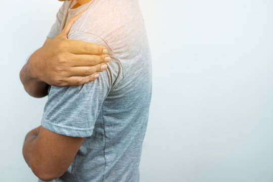 Man with pain in shoulder and upper arm, Ache in human body , closeup