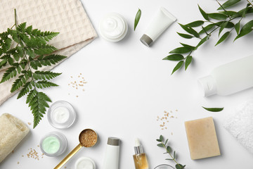 Flat lay composition with different body care products and space for text on white background Wall mural