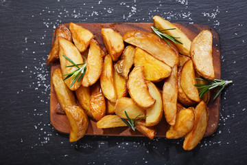 baked potato with rosemary, top view
