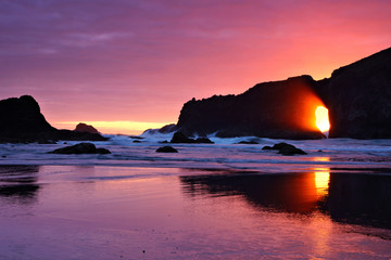 Beautiful sunset through sea arches at a beach in Olympic National Park, Washington, USA