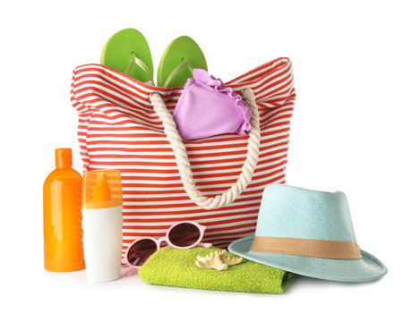 Composition with bag and beach accessories on white background