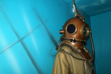 Brass helmet and retro suit for deep diving and copyspace.