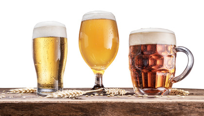 Wall Mural - Three different glasses of beer on wooden table. Clipping path.