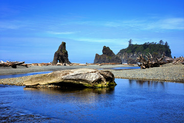Blue water and skies with sea stacks at Ruby Beach, Olympic National Park, Washington, USA