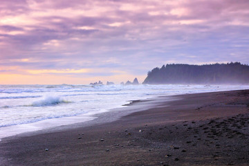 Wall Mural - Waves against the shore of Rialto Beach at sunset, Olympic National Park, Washington, USA
