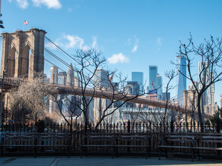 Brooklyn Bridge and Cityscape of New York skyline seen from riverside in Dumbo.