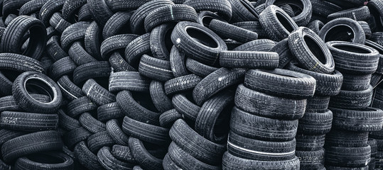 pile of used car tires Wall mural