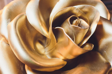 Amazing gold rose isolated. Golden Rose is a gold ornament, which popes of the Catholic Church have traditionally blessed annually.