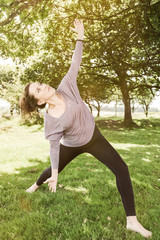 Active young woman exercise outdoor at summer time
