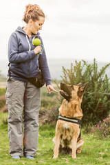 Active woman training session with dog outdoor