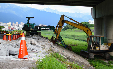 Construction Crew Digging Up Land For New Trail Construction