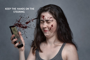 """The concept of a car accident, an insured event, attention at the wheel """" keep your hands on the wheel."""" A grimace of disgust on the girl's face, from blood splashes flying from the phone"""