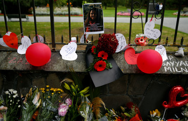 A picture of one of the victims is seen among the flower tribute at a memorial site for victims of the mosque shootings, at the Botanic Gardens in Christchurch