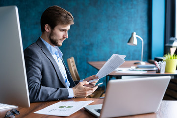 Business man working at office with laptop and documents on his desk, consultant lawyer concept.