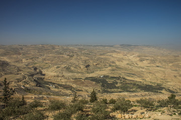 Jordanian desert from top of Holy Middle East mountain Nebo dry scenery landscape