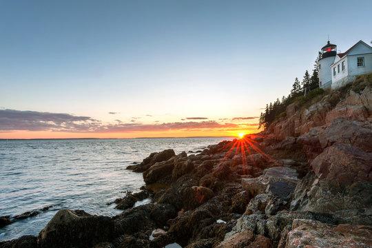 Sunset over picturesque Bass Harbor lighthouse on Mt Desert island, Maine