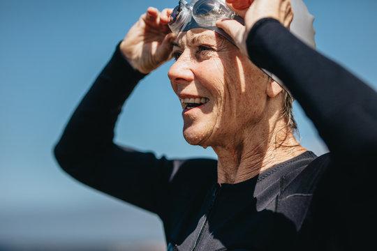 Close up of a senior female swimmer