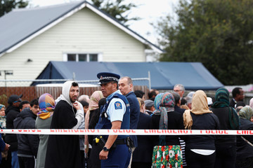 Members of Muslim religious groups gather for prayers outside the Linwood Mosque in Christchurch, New Zealand
