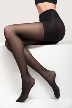 woman in black transparent pantyhose. legs