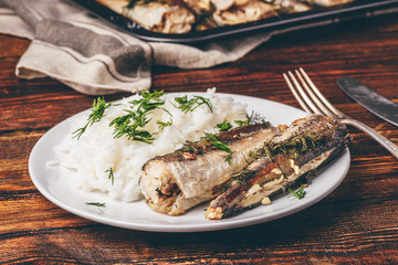 Baked hake carcasses with rice