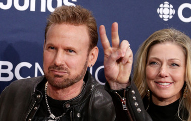 Corey Hart and his wife Julie Masse arrive at the 2019 Juno Awards in London, Ontario, Canada