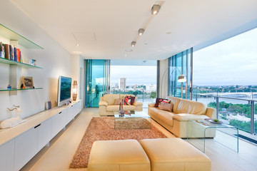 Clean living area with television