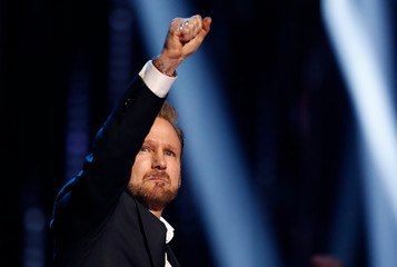 Corey Hart reacts after being inducted to the Canadian Music Hall of Fame at the 2019 Juno Awards in London, Ontario, Canada