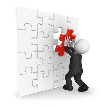 3d businessman in black suite assembling last puzzle piece