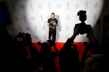 Corey Hart poses backstage with his Canadian Music Hall of Fame award at the 2019 Juno Awards in London, Ontario, Canada